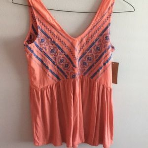 Coral embroidered sleeveless blouse